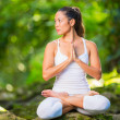 Stock Photo: Beautiful Young Woman in Lotus Position