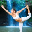 Woman Practacing Yoga in front of Beautiful Waterfall — Stock Photo