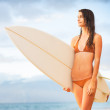 Surfer Girl on the Beach at Sunset — Stock Photo #33882655
