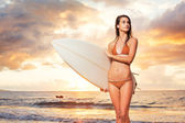 Surfer Girl on the Beach at Sunset — Stock Photo