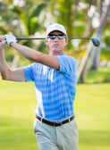 Athletic young man playing golf — Stock Photo