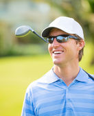 Athletic young man playing golf — Stockfoto