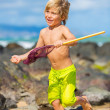 Young boy having fun on tropcial beach — Stock Photo
