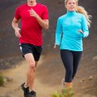 Fitness sport couple running jogging outside on trail — Stock Photo #34820617