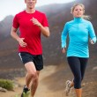 Fitness sport couple running jogging outside on trail — Stock Photo #34823681