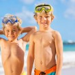 Two young boys having fun on tropcial beach — Stock Photo #34826107