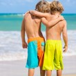 Two young boys having fun on tropcial beach — Stock Photo #34826899