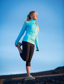 Young attractive athletic woman, wearing sporty cloths on trail, — Stock Photo