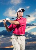 Golfer at sunset — Stock Photo