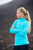 Young attractive athletic woman, wearing sporty cloths on trail — Stock Photo