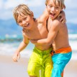 Two young boys having fun on tropcial beach — Stock Photo #34871453