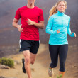 Fitness sport couple running jogging outside on trail — Stock Photo