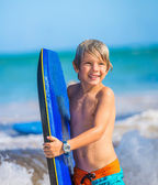 Happy Young boy having fun at the beach on vacation, — Stock Photo