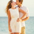 Young couple in love on the beach sunset — Stock Photo #36703345