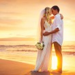 Bride and Groom, Kissing at Sunset on a Beautiful Tropical Beach — Stock Photo #37457277