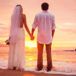 Bride and Groom, Enjoying Amazing Sunset on a Beautiful Tropical — Stock Photo #37457375