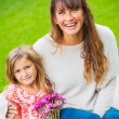 Portrait of happy mother and daughter — Stock Photo #37457597
