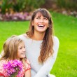 Portrait of happy mother and daughter — Stock Photo #37457635