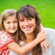 Portrait of happy mother and daughter — Stock Photo #37457673