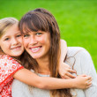 Portrait of happy mother and daughter — Stock Photo #37457675