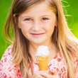 Cute little girl eating ice cream — Stock Photo