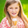 Stock Photo: Cute little girl eating ice cream