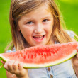 Stock Photo: Cute little girl eating watermelon