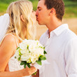 Bride and Groom, Romantic Newly Married Couple Kissing at the Be — Stock Photo #37459821