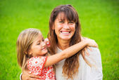 Portrait of happy mother and daughter — Stock Photo