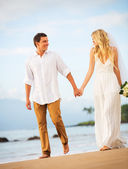 Bride and Groom, Romantic Newly Married Couple Holding Hands Wal — Stock Photo