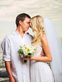 Bride and Groom, Romantic Newly Married Couple Kissing at the Be — Stock Photo