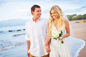 Bride and Groom Walking on Beautiful Tropical Beach at Sunset, R — Stock Photo
