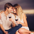 Couple drinking glass of wine on romantic sunset picnic — Stock Photo #37800751