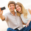 Couple taking photo of themselves with smart phone on romantic p — Stock Photo #37800783