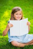 Adorable cute little girl reading book — Stock Photo