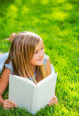 Adorable cute little girl reading book — Stock Photo