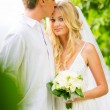 Stock Photo: Married couple, bride and groom getting married, Tropical weddin