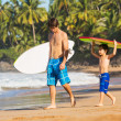 Father and Son Going Surfing Together on Tropical Beach in Hawai — Stock Photo #38632809