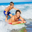 Father and Son Surfing Tandem Togehter Catching OceWave, Care — Stock Photo #38632829