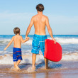 Father and Son Going Surfing Together on Tropical Beach in Hawai — Stock Photo #38632831