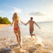 Happy Couple on Tropical Beach at Sunset — Stock Photo #38632933