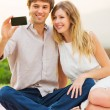 Stock Photo: Couple Taking Selfie With Mobile Phone