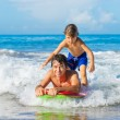 Father and Son Surfing Tandem Togehter Catching OceWave, Care — Stock Photo #38638281