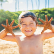 Happy young boy at the beach — Stock Photo #38638375