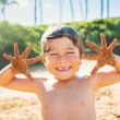 Stock Photo: Happy young boy at the beach