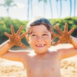 Happy young boy at the beach — Stock Photo #38638389