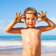 Happy young boy at the beach — Stock Photo