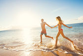 Happy Couple on Tropical Beach at Sunset — Stock Photo