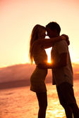 Silhouette of Romantic Couple Kissing at Sunset — Stock Photo