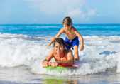Father and Son Surfing Tandem Togehter Catching Ocean Wave, Care — Stock Photo